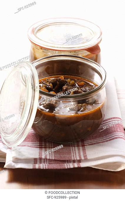 Venison ragout in preserving jars