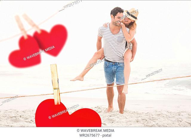 Composite image of romantic couple enjoying on the beach