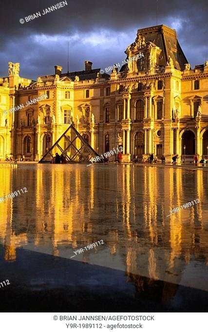 Sunlight and reflections at Musse du Louvre, Paris France