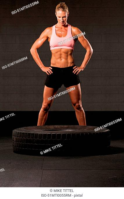 Woman working out with tire