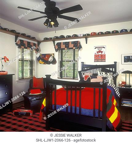 CHILDREN'S BEDROOM: Boy's room with patriotic theme. Dark wood bed with red, white, and blue bedding, colonial flag pattern, window treatments
