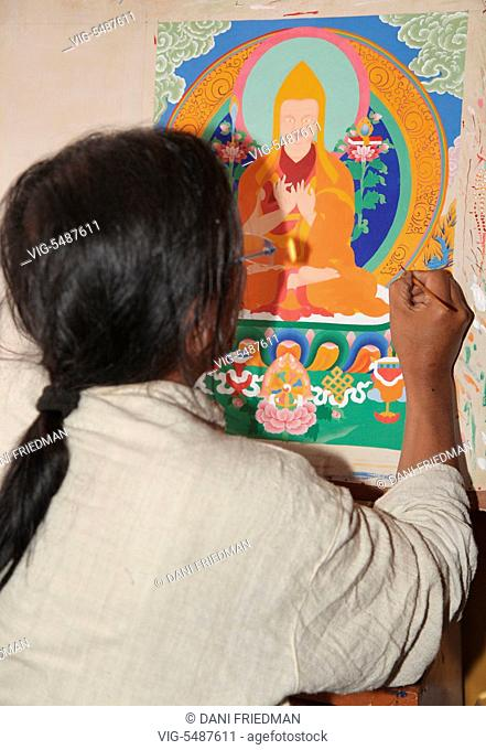 Artist painting a Buddhist thangka in Leh, Ladakh, Jammu and Kashmir, India. (This image has a signed model release). - LEH, LADAKH, INDIA, 03/07/2014