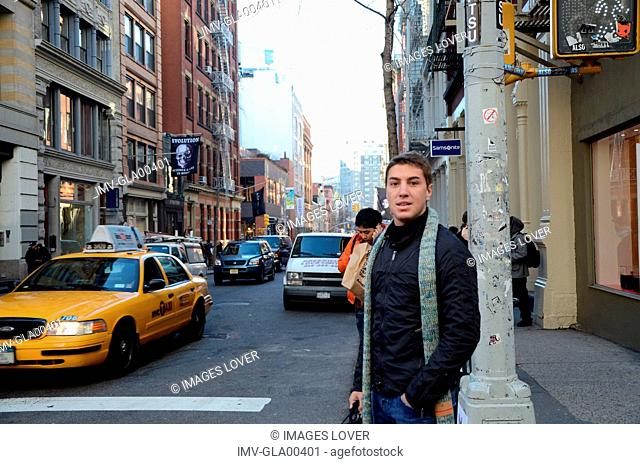 Young Man walking on streets of Greenwich Village, New York, USA