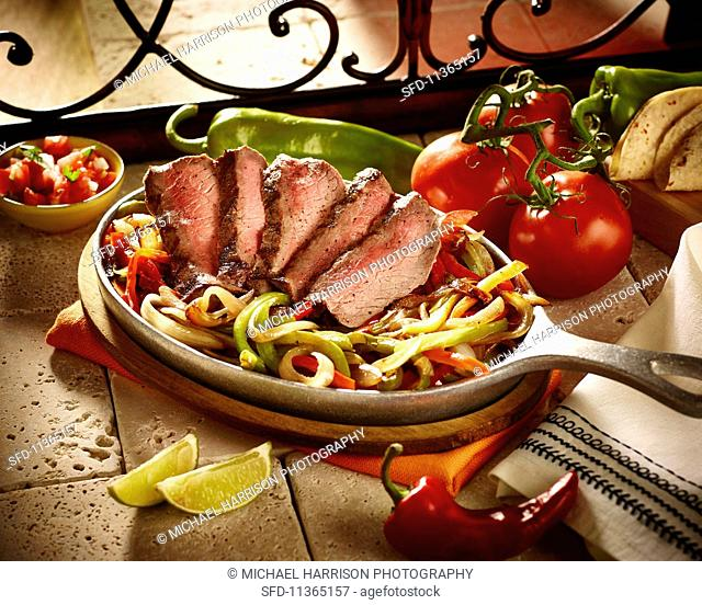 Beef fajitas with peppers and onions