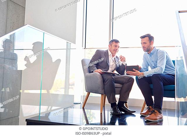 Business men with digital tablet in meeting