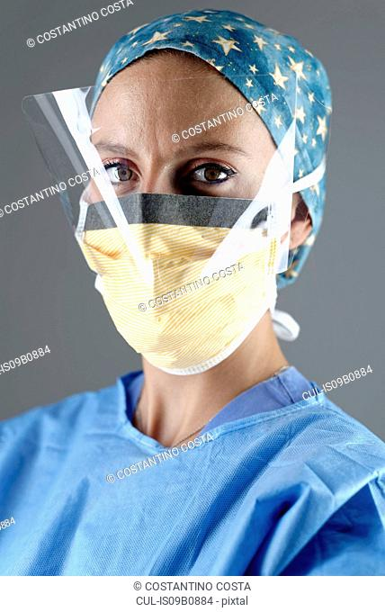 Surgeon wearing surgical eye guard and face mask looking at camera