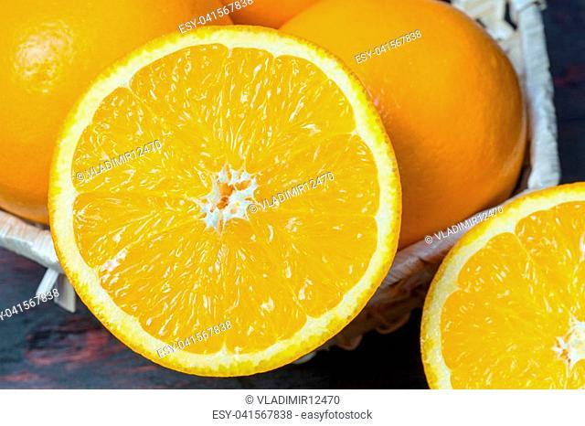 Juicy orange cut in half to make orange juice for Breakfast