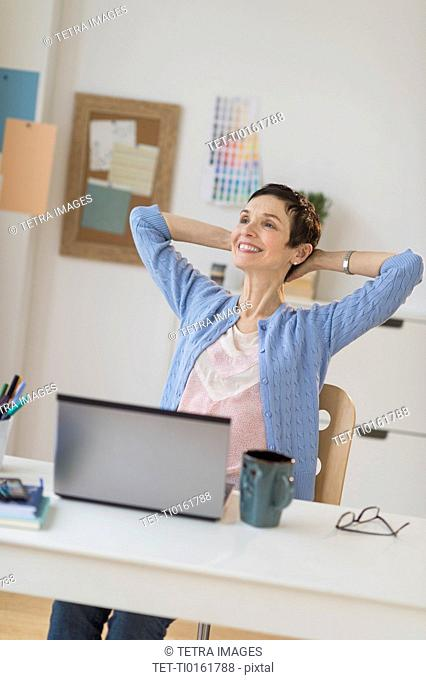 Woman relaxing in home office