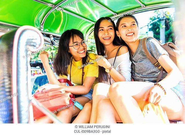 Friends sightseeing in tuk tuk car, Bangkok, Thailand
