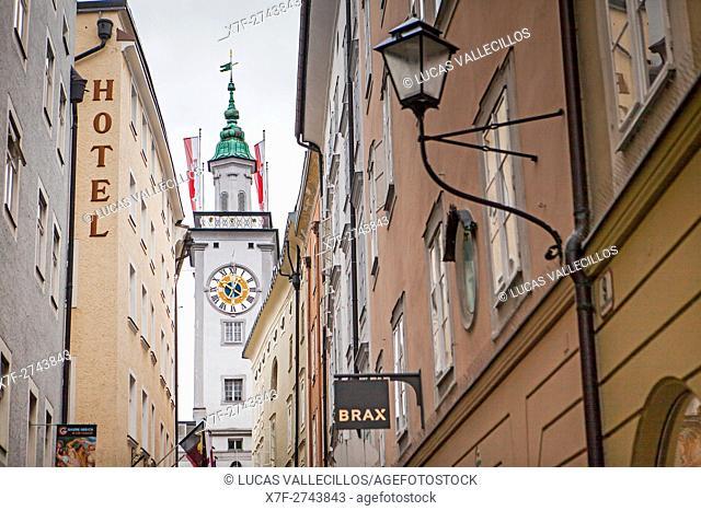 Sigmund-Haffner-Gasse, in background Tower of the old town hall with clock, Salzburg, Austria