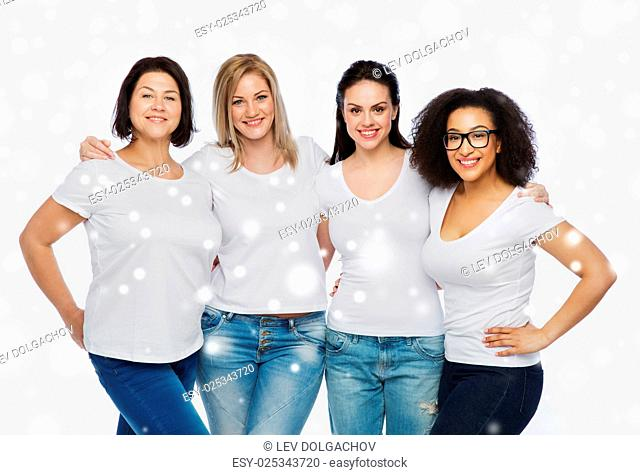 friendship, diverse, body positive and people concept - group of happy different size women in white t-shirts hugging over snow