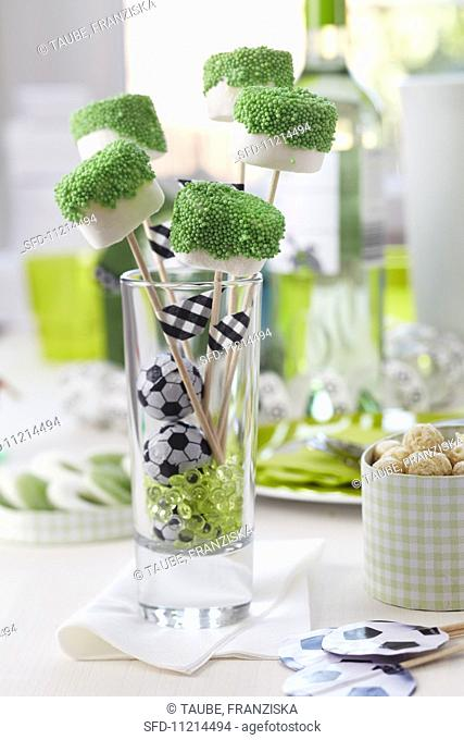 Marshmallows on sticks dipped in green sugar sprinkles