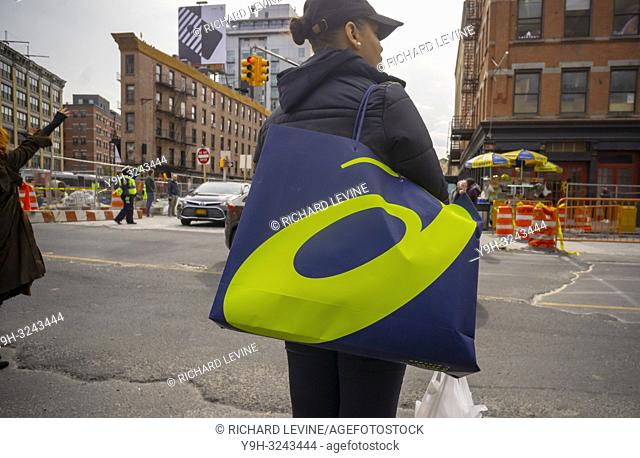 A woman with a shopping bag with her Asics brand purchases in the Meatpacking district in New York on Friday, October 26, 2018