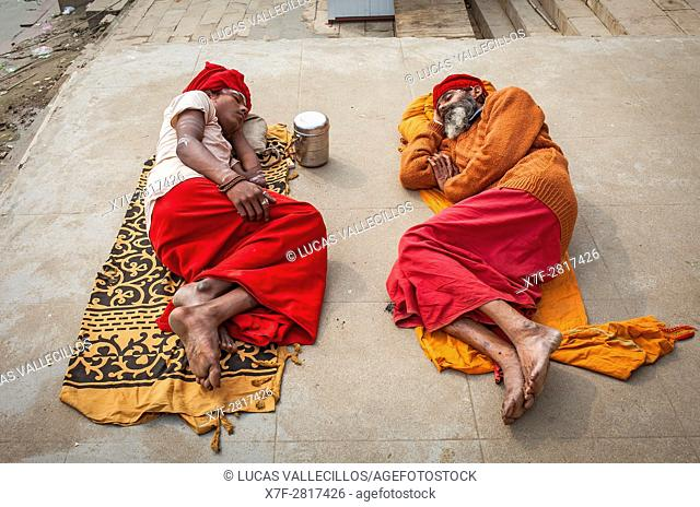 Sadhus sleeping, in the ghats of Ganges river, Varanasi, Uttar Pradesh, India