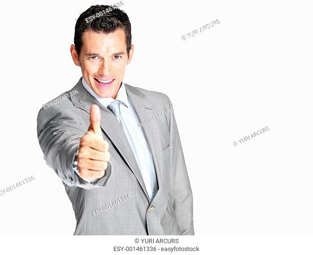 Portrait of a smiling young male entrepreneur showing thumbs up sign against white background