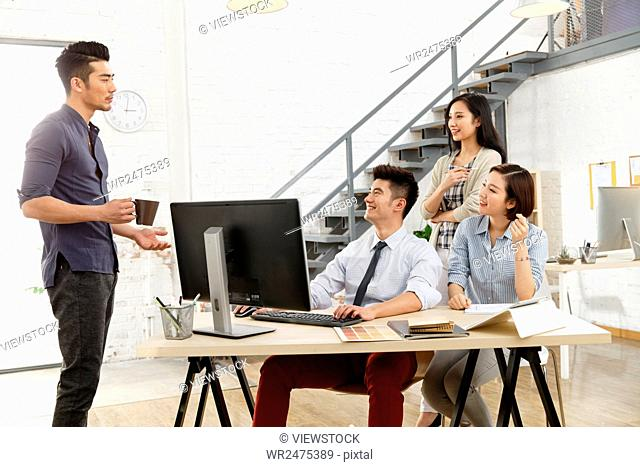 Business men and women work in the studio