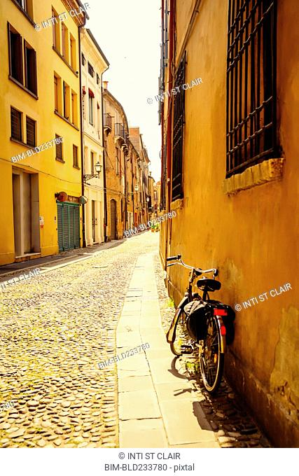 Bicycle leaning in building near street, Bologna, Emilia-Romagna, Italy
