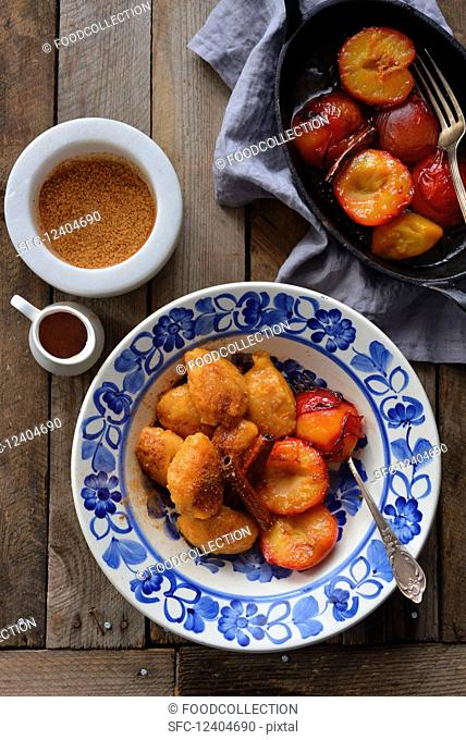 Sweet potato dumplings served with caramel plums