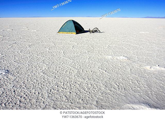 A tent and a bicycle on the frozen salt lake called 'Salar de Uyuni' in Bolivia