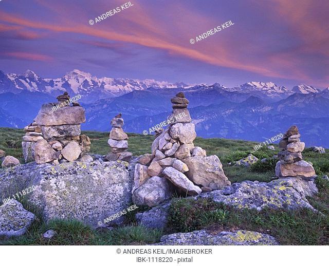 Steinmandli, piled stone cairns, at dusk, Niederhorn Mountain, Bern, Switzerland, Europe