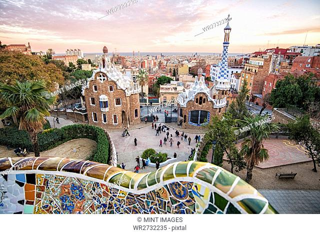 View over Barcelona rooftops from the Parc Guel and landmarks of Gaudi architecture