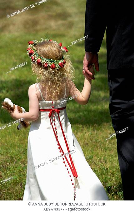 Girl holding father's hand