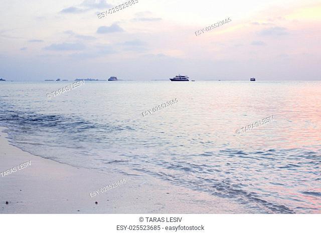 Tropical sunrise near the island beach at Maldives