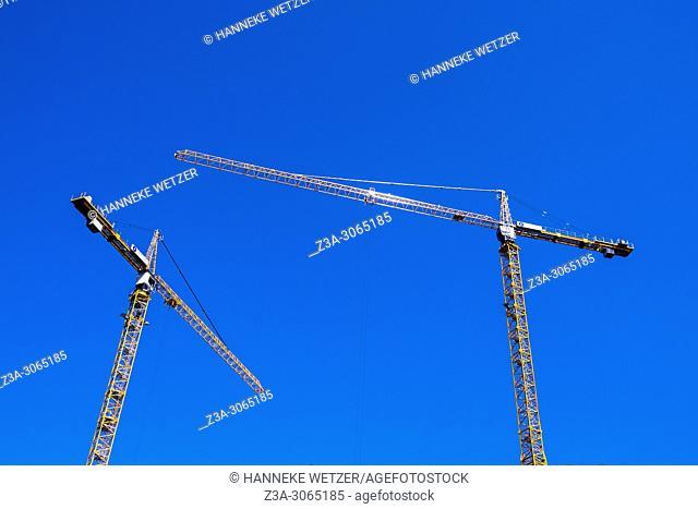 Orange cranes and blue sky, Brussels, Belgium, Europe