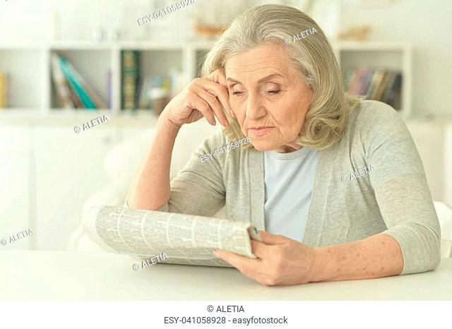 Portrait of a senior woman with newspaper