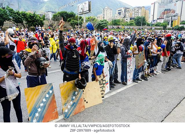 Protesters sing the national anthem of Venezuela in protest. Opposition protesters assembled on the Francisco Fajardo motorway