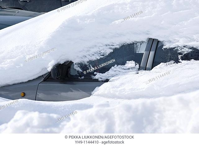 A Snow Covered Car
