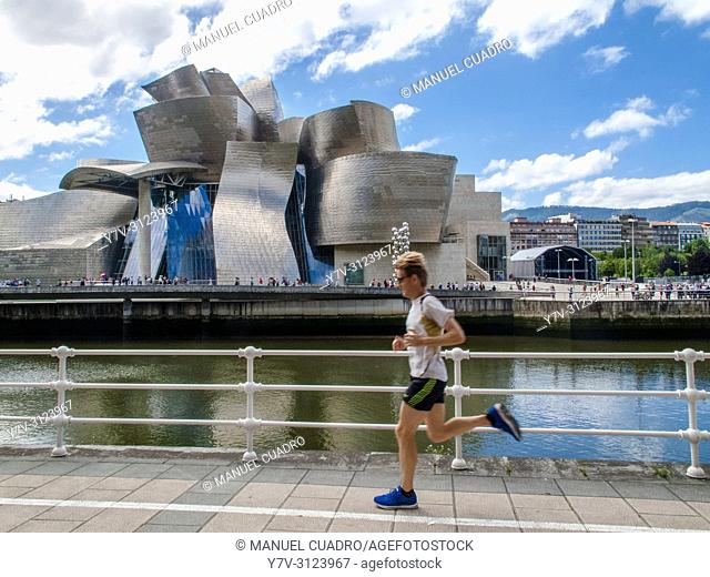 Jogger in front of Guggenheim Museum, Bilbao, Biscay, Basque Country, Spain