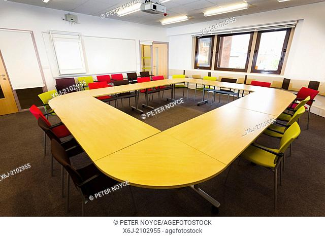 Unoccupied conference table layout in office