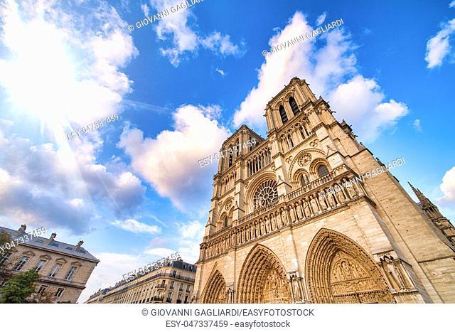 Notre Dame majestic facade against a beautiful blue sky, Paris
