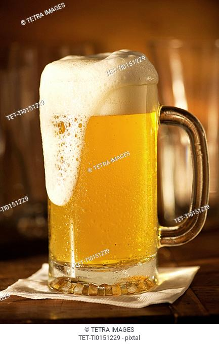 Lager in beer glass on bar counter