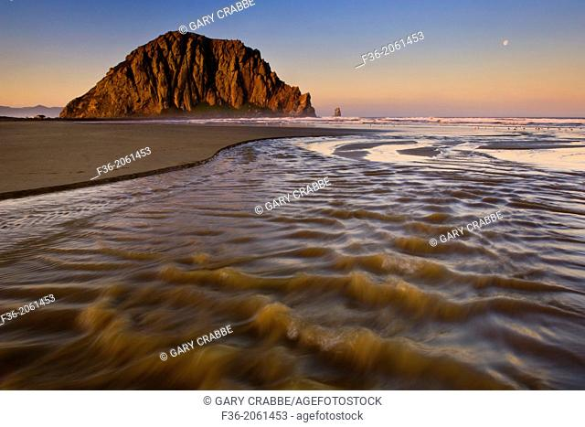 Sunrise light on Morro Rock over Little Morro Creek, Morro Strand State Beach, Morro Bay, California