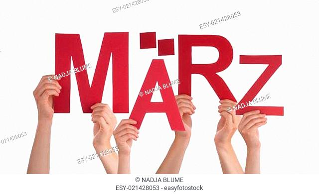 Many Caucasian People And Hands Holding Red Letters Or Characters Building The Isolated German Word Maerz Which Means March On White Background