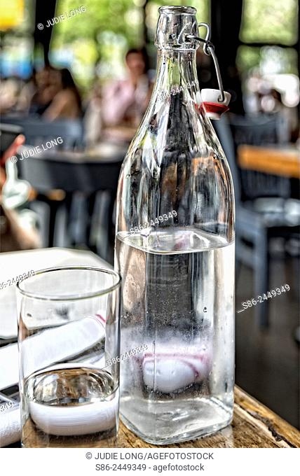 Bottle and Glass of Water on a New York City Restaurant Table