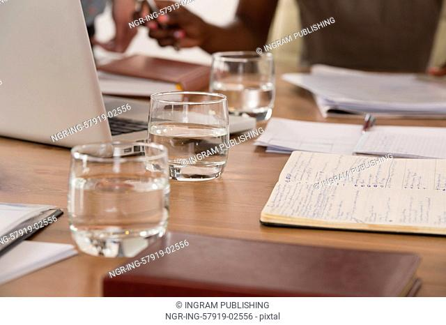 Image of glasses of water during discussion at meeting