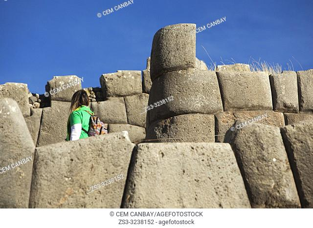 Visitor at the The Saqsaywaman archaeological complex, a massive fortress of the Incas, overlooking the Inca navel of Cusco, Peru, South America