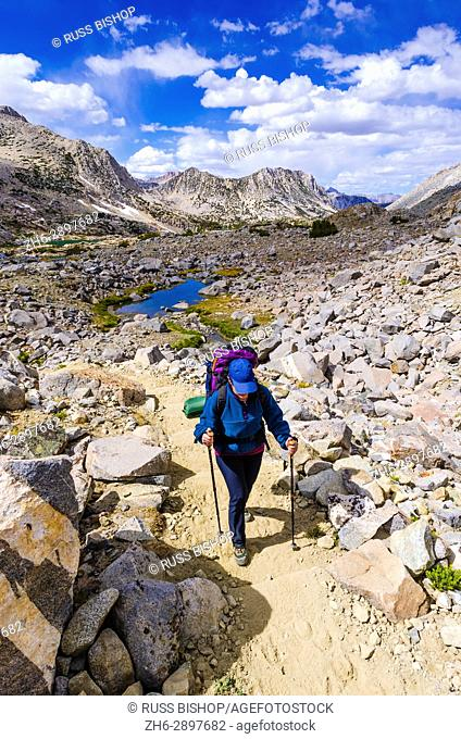 Backpacker on the Bishop Pass Trail, John Muir Wilderness, Sierra Nevada Mountains, California USA