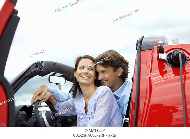 Couple close together in an electric car