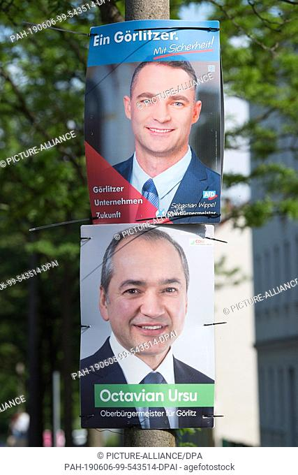 05 June 2019, Saxony, Görlitz: Election posters with the photos of the two Lord Mayor candidates for Görlitz, Sebastian Wippel (AfD