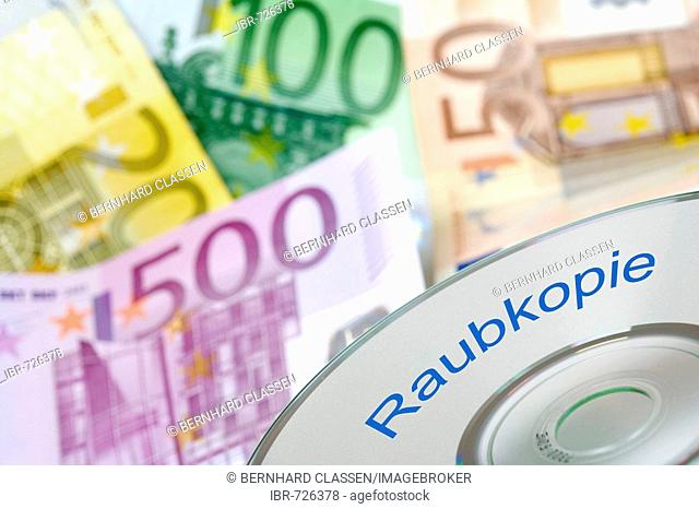 Disc with writing Raubkopie (pirated copy) in front of Euro banknotes