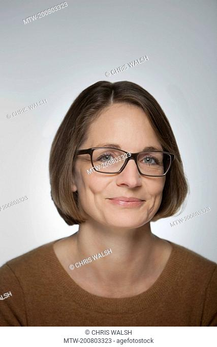 Woman portrait smiling glasses mature middle aged