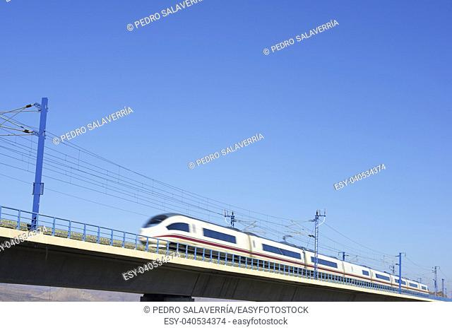 view of a high-speed train crossing a viaduct in Zaragoza Province, Aragon, Spain. AVE Madrid Barcelona