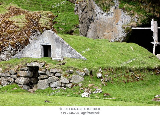 abandoned covered icelandic turf house now used as a field store iceland