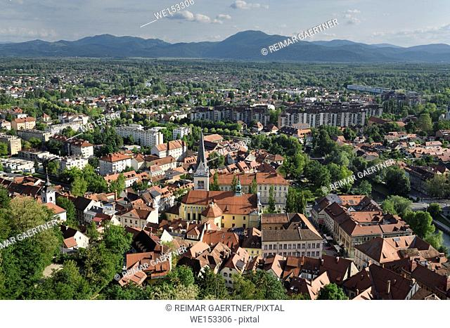 Ljubljana capital city of Slovenia with the Karawanks Alps foothills former marsh land and St James's Catholic church from Ljubljana Castle Hill
