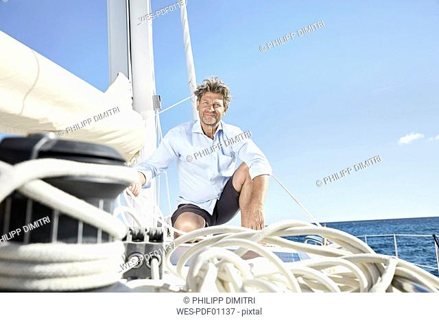 Portrait of smiling mature man on his sailing boat
