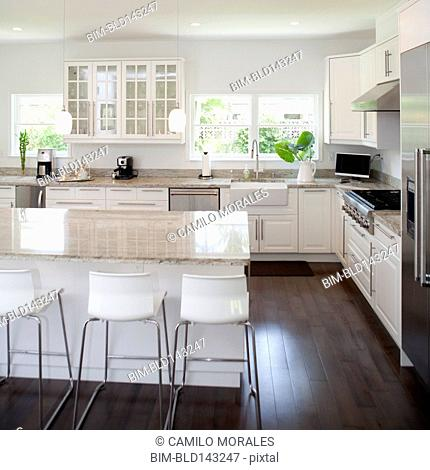 Stools, breakfast bar and counters in modern kitchen